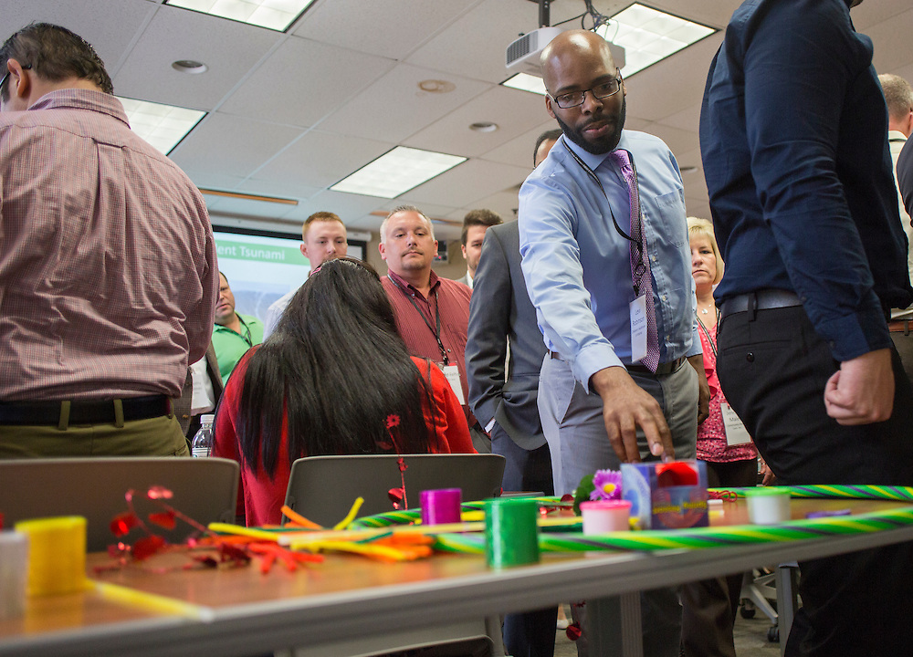 Attendees of the College of Business Center for Leadership Event pick out toys that they consider flexible during a breakout session led by Lisa George, the Vice President of International Talent for Walmart, on April 23, 2016.