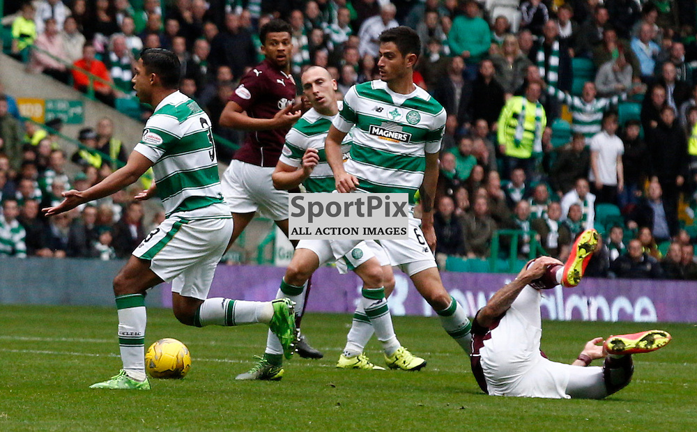 Celtic v Hearts....Emilio Izaguirre receives a yellow card from referee Kevin Clancy after fouling Juanma Delgado...(c) STEPHEN LAWSON | SportPix.org.uk