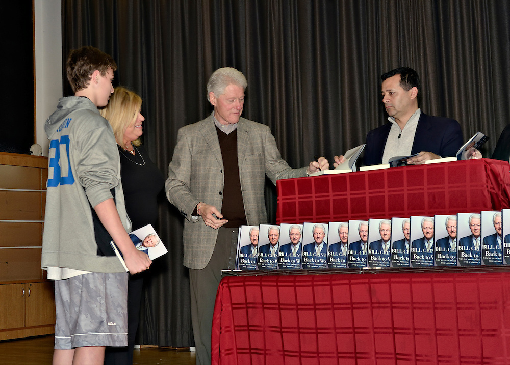 President Bill Clinton signs copies of his new book Back to Work at his hometown library in Chappaqua, New York. Approximately 500 people attended the book signing on Friday, December 9, 2011. The Village Bookstore, in neighboring Pleasantville, NY, donated 10% of the profits from the books sold to the library.