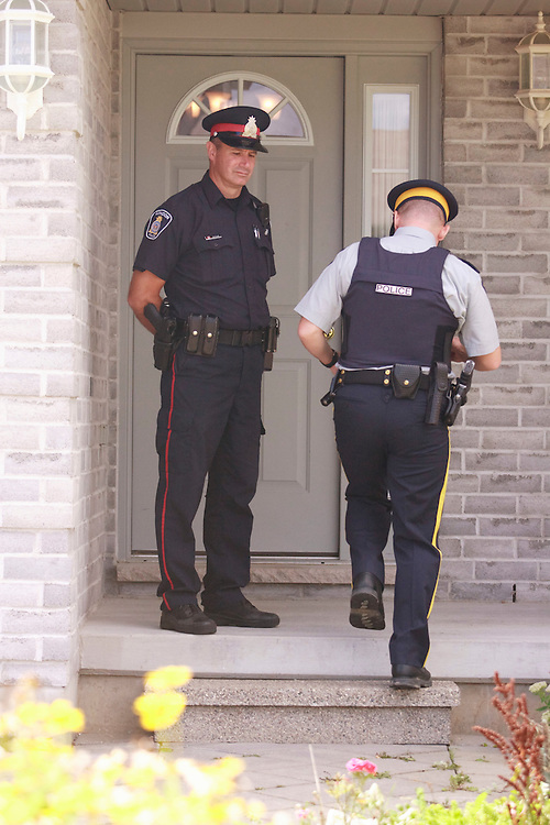 London, Ontario ---10-08-26--- RCMP investigators remove evidence from a home in London, Ontario August 26, 2010 where they arrested a man in a Terrorism related investigation.<br /> GEOFF ROBINS The Globe and MailLondon, Ontario ---10-08-26---Police stand guard at a home in London, Ontario August 26, 2010 where they arrested a man in a terrorism related investigation.<br /> GEOFF ROBINS The Globe and Mail