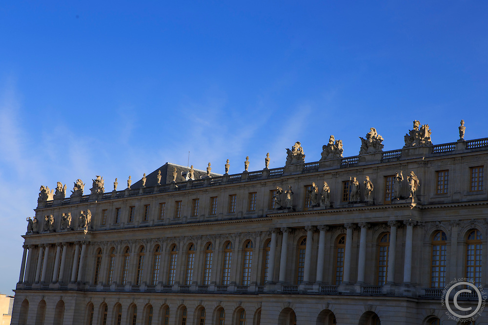 Late afternoon sun strikes the rear facade of Chateau Versaille, Paris, France
