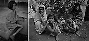 Children and mothers waiting to visit a medical clinic outside Dhaka, Bangladesh. (1975)