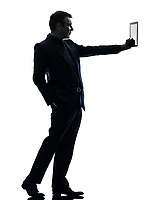 one  business man holding digital tablet in silhouette on white background