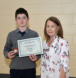 Rice College Awards Night<br /> Junior student James Keane accecpting his Art award from Ms Julie Kennedy.<br />
