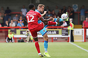 Nathan Ferguson and Chris Hussey   during the EFL Sky Bet League 2 match between Crawley Town and Cheltenham Town at The People's Pension Stadium, Crawley, England on 31 August 2019.
