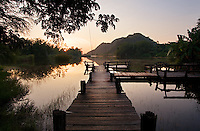 Wooden jetty on a lake at sunset, Phetchaburi province, Thailand