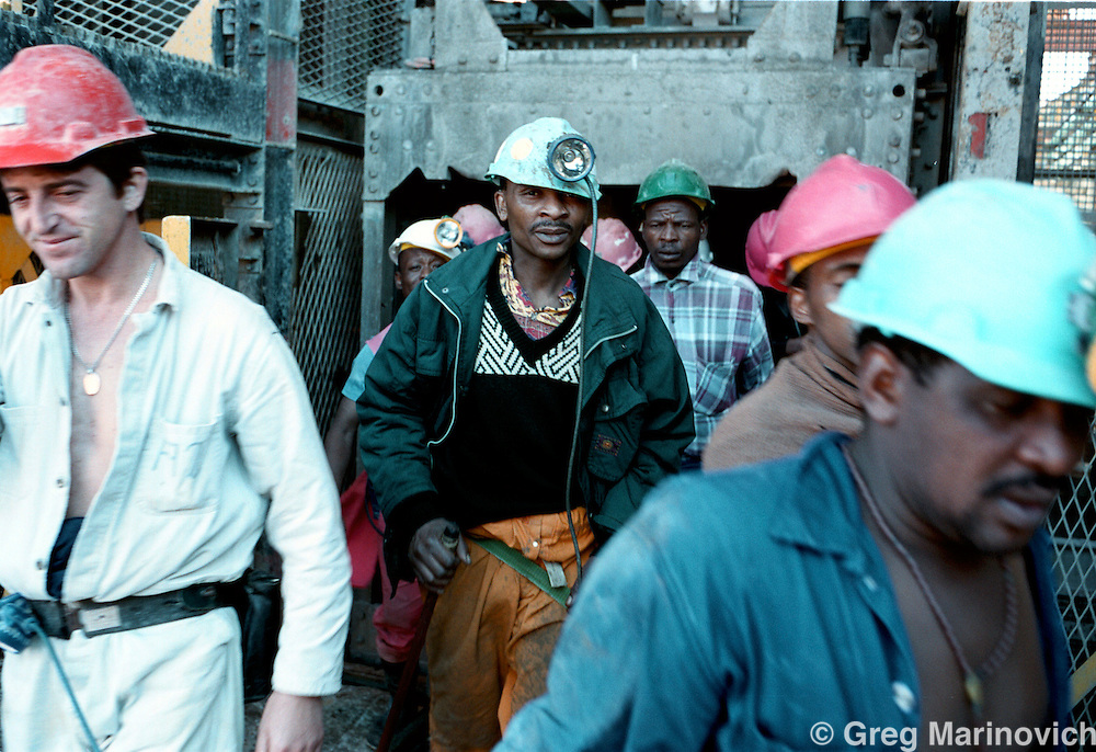IPMG0387 South Africa, Western Deep, 2000: .Miners exit a lift from their eight hour shift underground working on the gold-bearing ore at Anglo Gold's Savuka mine (formerly Western Deep Levels East) the world's deepest mine May 23, 2000, south-west of Johannesburg, South Africa. . .Photograph by Greg Marinovich