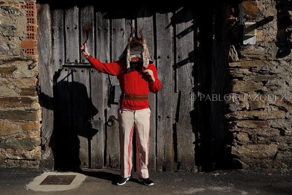A man dressed as El Diablo (the devil) poses for a portrait during La Filandorra festival on December 26, 2016 in the small village Ferreras de Arriba, Zamora province, Spain.  La Filandorra festival is a pagan winter masquerade that takes place during Saint Esteban festivities. The parade is represented by four characters, La Filandorra, El Diablo (Devil), La Madama (madame) y El Galán (Gallant). (© Pablo Blazquez)