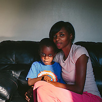East Chicago, Indiana<br /> <br /> Stephanie King embraces her youngest son, Josiah King, 3, whose blood lead levels test results were above the CDC&rsquo;s 5 mg/d threshold for action. Two and a half years ago, King left Chicago's South Side to find a safer environment for her four sons and one daughter. &ldquo;If I&rsquo;d have known the dirt had lead, he wouldn&rsquo;t have been out there playing in it,&quot; King said.<br /> <br /> ||||<br /> <br /> The West Calumet Housing Complex, which is currently home to about 1,200 people, is located on a 79-acre Environmental Protection Agency Superfund site where a USS Lead facility was located in East Chicago, Indiana. Up until 1985, a lead refinery, a copper smelter and a secondary lead smelter were also in the area. The houses were built between the late 1960s and early 1970s.<br /> <br /> East Chicago is zoned close to 80 percent heavy industrial, and the local government relies on the patronage, jobs and tax revenue that the oil and steel industries bring. However, many jobs disappeared when the steel industry modernized and shifted overseas in the late 20th century, leading to extensive job loss for the working class. People there have a long, complicated relationship with industry -- and its environmental legacy will affect generations to come.<br /> <br /> Photo by Alyssa Schukar