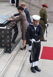 The Duke and Duchess of Sussex lay palm leaves on the tomb of the unknown soldier during a visit to the newly unveiled UK war memorial and Pukeahu National War Memorial Park, in Wellington, on day one of the royal couple's tour of New Zealand.