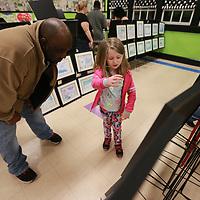 Quitman Spaulding listens to Kaytlyn Foy, 6, describe her artwork at Joyner Elementary School.