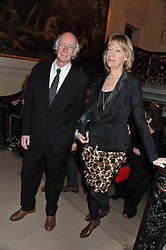 ROGER McGOUGH and his wife HILARY at a private view to celebrate the opening of the Royal Academy's exhibition of work by David Hockney held at The Royal Academy, Burlington House, Piccadilly, London on 17th January 2012.