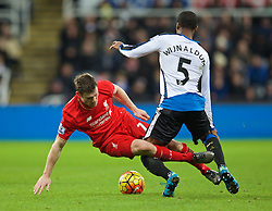 NEWCASTLE-UPON-TYNE, ENGLAND - Sunday, December 6, 2015: Liverpool's James Milner tackles Newcastle United's Georginio Wijnaldum during the Premier League match at St. James' Park. (Pic by David Rawcliffe/Propaganda)
