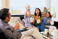 Family Eating Chinese Take-out --- Image by © Jim Cummins/CORBIS
