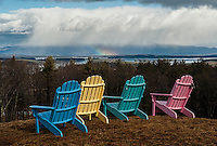 Rainbow colored chairs over looking Lake Winnipesaukee.   Karen Bobotas Photographer