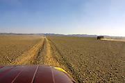GOBI DESERT, MONGOLIA..08/29/2001.Near Mount Burkhan Khailaast. Jeeps and kitchen truck of Nomads Tours..(Photo by Heimo Aga).