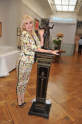 JOANNA LUMLEY at a reception to unveil the Limited Centenary Edition of Sir George Frampton's statuette of Peter Pan in aid of the Moat Brae Charity held at The Fine Art Society, 148 New Bond Street, London on 1st May 2012.