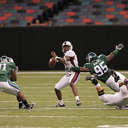 20 September 2008: Louisiana-Monroe quarterback Kinsmon Lancaster (7) pressured by Tulane defensive tackle Justin Adams (95) during a Conference USA match up between the University of Louisiana Monroe and Tulane at the Louisiana Superdome in New Orleans, LA.