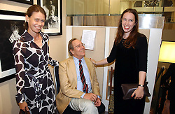The EARL OF SNOWDON and his daughters left, LADY SARAH CHATTO and LADY FRANCES ARMSTRONG-JONES at an exhibition of photographs by Lord Snowdon held at the Chris Beetles Gallery, Ryder Street, London on 18th September 2006.<br />