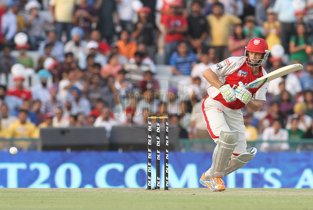 Captain Adam Gilchrist of the Kings XI Punjab sets off for a run  during match 9 of the Indian Premier League ( IPL ) Season 4 between the Kings XI Punjab and the Chennai Super Kings held at the PCA stadium in Mohali, Chandigarh, India on the 13th April 2011..Photo by Shaun Roy/BCCI/SPORTZPICS