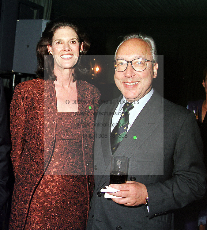 MR & MRS URS SCHWARZENBACH he is the Swiss multi <br /> millionaire,  at a party in London on 11th May 2000.ODT 40 2oro