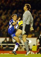 Photo: Chris Ratcliffe.<br />Arsenal v Blackburn Rovers. The Barclays Premiership.<br />26/11/2005.<br />Craig Bellamy (L) goes in hard on Jens Lehmann