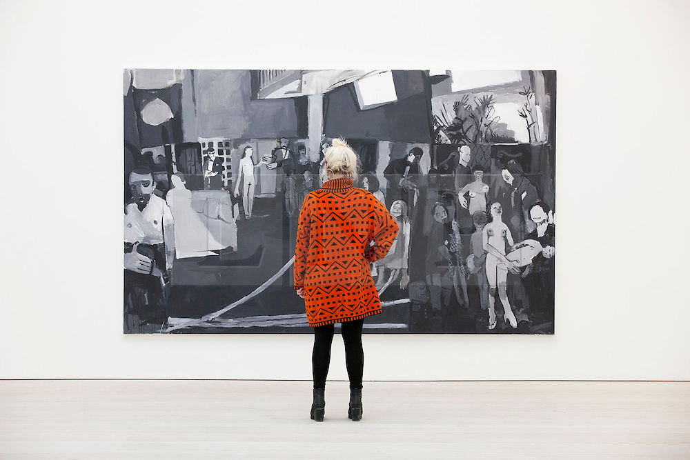 © Licensed to London News Pictures. 19/11/2013. London, UK. A Saatchi Gallery employee views 'Thingly Character IV' (2010), an acrylic on canvas by Dutch artist Helen Verhoeven, at the press view for 'Body Language' a new exhibition at the gallery in London today (19/11/2013). Focussing on the human form, the exhibition features the work of 19 emerging international artists and opens to the public on the 20th of November 2013. Photo credit: Matt Cetti-Roberts/LNP