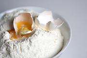 Close up of egg and flour