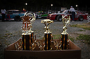 Trophies for the evening's races sit in a box in the pits as cars prepare to begin time trials at Agassiz Speedway in Agassiz, BC (2012)
