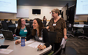 Megan Bulow, center gets to know others at her table during the Discovering Common Ground icebreaker while Linda Knopp, left, and Christina McGuire, right, talk at the Marketing Symposium in Schoonover Center on November 4, 2015. Photo by Emily Matthews