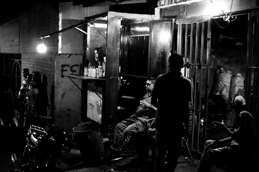 Street scene at night in Petare, one of the most violent areas of Venezuela, reporting over a dozen homicides every weekend.