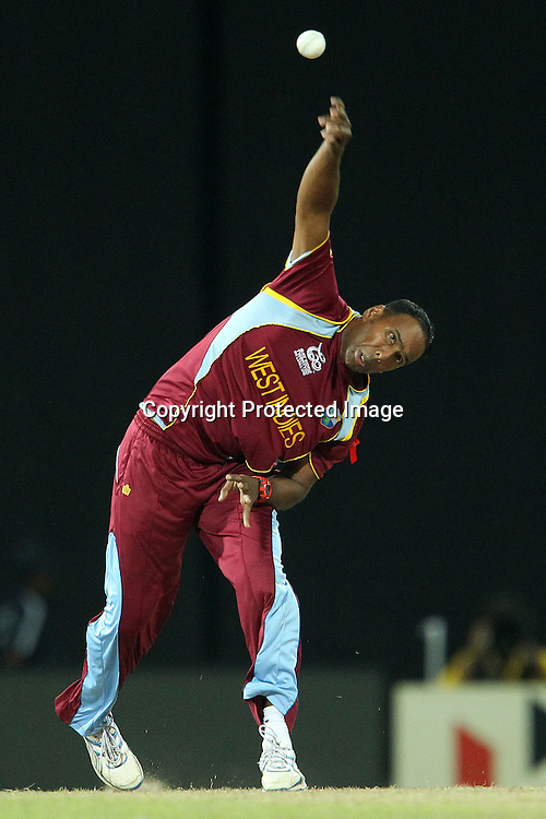 Samuel Badree of The West Indies bowls during the ICC World Twenty20 semi final match between Australia and The West Indies held at the Premadasa Stadium in Colombo, Sri Lanka on the 5th October 2012<br /> <br /> Photo by Ron Gaunt/SPORTZPICS