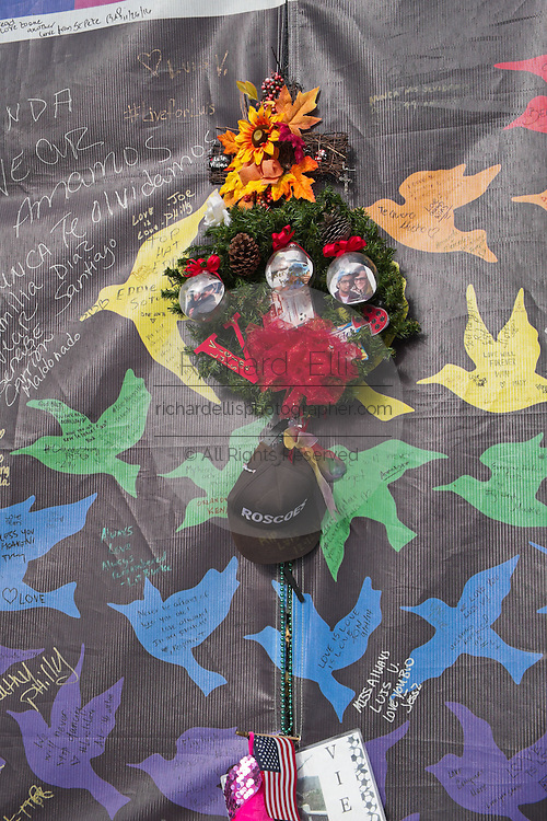 A Christmas wreath is left amongst the tributes at a makeshift memorial around the Pulse Nightclub December 18, 2016 in Orlando, Florida. On June 12, 2016 49 people were killed and 53 injured in the deadliest mass shooting by a single gunman in U.S. history, and the deadliest terrorist attack on U.S. soil since the events of September 11, 2001.