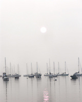 Boats in fog along Morrissey Boulevard in Dorchester, Ma.