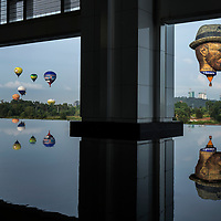 Hot air balloons including the Vincet Van Gogh balloon (R) fly over Putrajaya's sky during the 7th International Hot Air Balloon Fiesta 2015 in Putrajaya, Malaysia. Balloonists from 11 countries including the Philippines, South Korea, the United States, Australia and Belgium take part to fly their balloons over Malaysia administrative capital, Putrajaya.