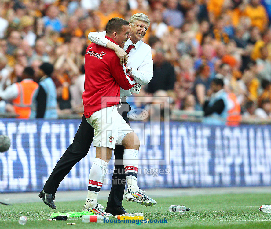 Ars&egrave;ne Wenger ( R ), Manager of Arsenal celebrates with Lukas Podolski at the final whistle during the The FA Cup Final match at Wembley Stadium, London<br /> Picture by Paul Terry/Focus Images Ltd +44 7545 642257<br /> 17/05/2014