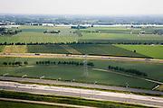 Nederland, Gelderland, Valburg-Elst, 28-06-2006; Betuweroute: in de voorgrond de opstelsporen, daarachter het hoofdspoor van de goederenspoorlijn (naar links, Oostelijk - richting Duitsland), het geheel wordt gebruikt voor de overslag van containers, het CUP: Container Uitwissel Punt; in het midden autosnelweg A15, daarachter (Zuidelijk), de Waal; het gehele gebied op de foto zou in de toekomst het multimodaal transport centrum moeten worden. Het MTC zou moeten dienen voor overslag van goederen tussen spoor, wegtransport en binnenvaart, maar is omstreden en het is de vraag of het er ooit zal komen; vrachtvervoer, milieu, transport, infrastructuur, infrabundel, verkeer en vervoer, goederen spoorlijn, mobiliteit, planologie; ook (lucht)foto's van de bouwfase en andere (lucht)foto's van deze lokatie; deel van de serie Panorama Nederland luchtfoto (toeslag aerial photo (additional fee required .foto Siebe Swart / photo Siebe Swart