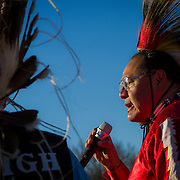 Dennis Zotigh, Kiowa, right, speaks during a protest and march from in front of the U.S. Capitol to the EPA, about the North Dakota Access Pipeline, as well as the effort to free Leonard Peltier.  Saturday, December 10, 2016. John Boal Photography