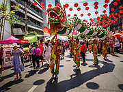 05 FEBRUARY 2019 - BANGKOK, THAILAND: A Dragon Dance team performs on Yaowarat Road in Bangkok during Chinese New Year celebrations. Chinese New Year celebrations in Bangkok started on February 4, 2019, although the city's official celebration is February 5 - 6. The coming year will be the Year of the Pig in the Chinese zodiac. About 14% of Thais are of Chinese ancestry and Lunar New Year, also called Chinese New Year or Tet is widely celebrated in Chinese communities in Thailand.      PHOTO BY JACK KURTZ