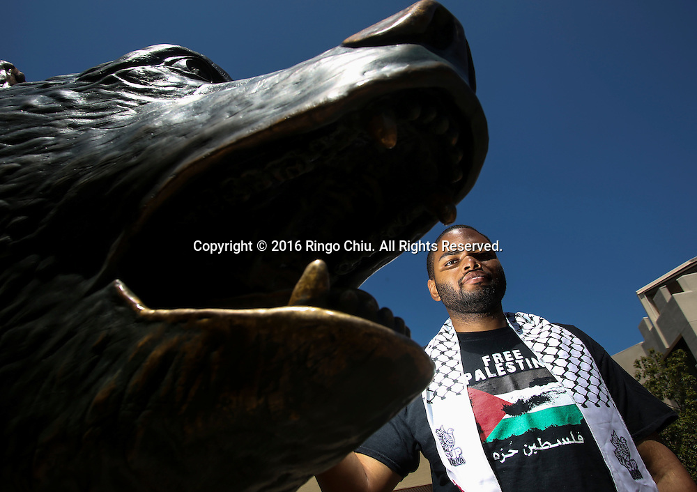 LOS ANGELESE, CA - AUGUST 11, 2016: Robert Gardner, a UCLA fourth-year student and African American activist with Students for Justice in Palestine, poses at UCLA's Bruin Bear statue, on Thursday, Aug. 11, 2016. (Photo by Ringo H.W. Chiu / For The Times)(Photo by Ringo Chiu/PHOTOFORMULA.com)<br /> <br /> Usage Notes: This content is intended for editorial use only. For other uses, additional clearances may be required.
