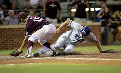 TCU's Luken Baker (19) is called safe at home after a wild pitch as Texas A&M's Brigham Hill (15) tries to apply a tag during the 5th inning of a NCAA college baseball super regional tournament game, Friday, June 10, 2016, in College Station, Texas. (AP Photo/Sam Craft)