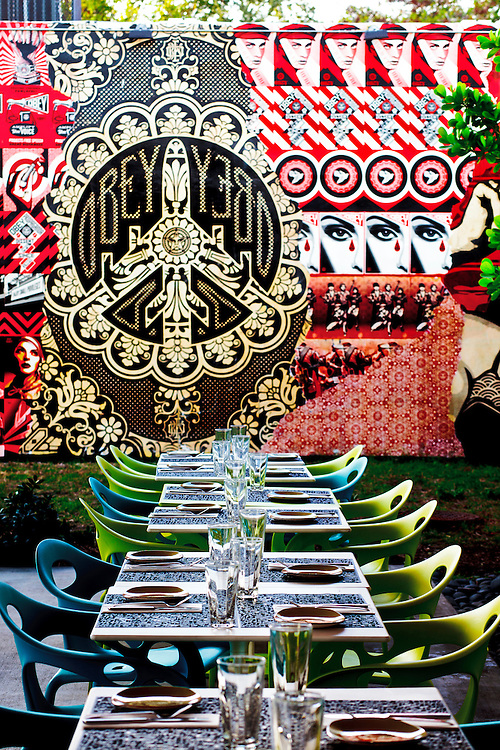Mural by street artist Shepard Fairey at the Wynood Kitchen and Bar restaurant in the popular Wynwood Walls complex founded by visionary real estate redeveloper Tony Goldman