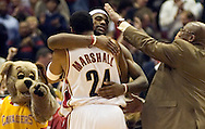 PHOTO BY DAVID RICHARD.LeBron James is congratulated by teammate Donyell Marshall and head coach Mike Brown after James' bucket in overtime gave the Cavaliers a 120-118 win over visiting Charlotte.