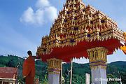 Buddhist monk painting Wat Patong temple on Phuket Island, Thailand