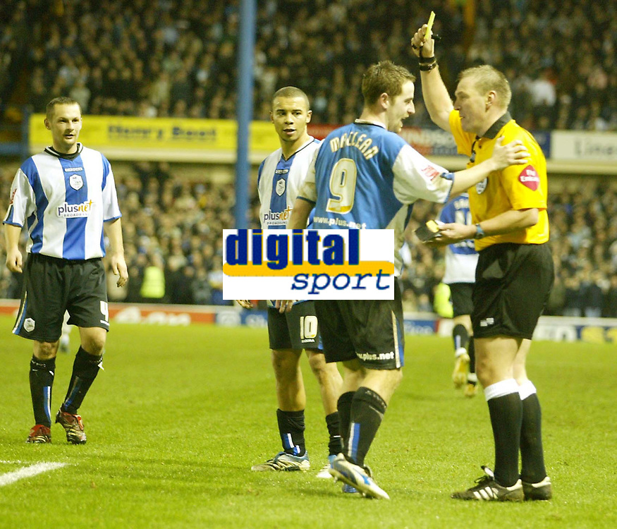 Photo: Aidan Ellis.<br /> Sheffield Wednesday v Manchester City. The FA Cup. 07/01/2007.<br /> Wednesday's Steven McLean recieves a yellow card from Graham poll for celebrating with the fans