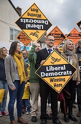 © Licensed to London News Pictures. 03/05/2017. Kidlington, UK.Party supporters hold up placards ( one upside down) as Liberal Democrat leader Tim Farron campaign in Kidlington. Photo credit: Peter Macdiarmid/LNP
