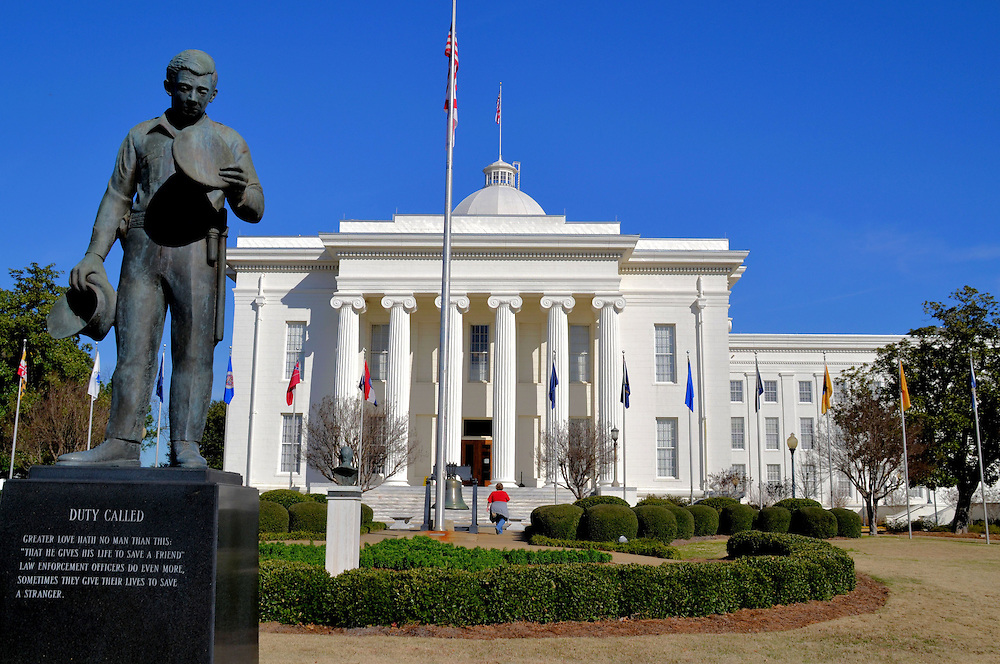 Alabama State Capitol Building in Montgomery, Alabama<br /> The Alabama State Capitol in Montgomery opened in 1851.  It was Alabama&rsquo;s fifth capital and was built in the Greek Revival style on Goat Hill.  It was on this front portico where Jefferson Davis became President of the Confederate States in 1861 and where Martin Luther King staged a protest 105 years later.  In the foreground is &ldquo;Duty Called,&rdquo; a bronze memorial statue by Branko Medenica that honors fallen police officers.  Alabama became the 22nd state on December 14, 1819.