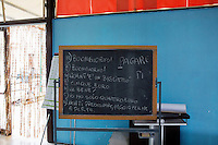 SALEMI, ITALY - 9 DECEMBER 2014: The blackboard used by the Italian teacher at the CAS (Special Accommodation Center) in Salemi, Italy, on December 9th 2014.<br /> <br /> The CAS (Special Accommodation Center) in Salemi, Sicily, hosts a total of 77 migrants from Nigeria, Mali, Togo Senegal, Gambia, Bangladesh, Camerou, Egypt, Ivory Coast, Burkina Faso and Pakistan.