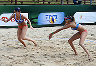 STARE JABLONKI POLAND - July 1: Taliqua Clancy and Louise Bowden /R/ of Australia in action during Day 1 of the FIVB Beach Volleyball World Championships on July 1, 2013 in Stare Jablonki Poland.  (Photo by Piotr Hawalej)