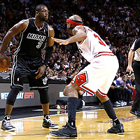 29 January 2012: Chicago Bulls shooting guard Richard Hamilton (32) defends on Miami Heat shooting guard Dwyane Wade (3) during the Miami Heat 97-93 victory over the Chicago Bulls at the AmericanAirlines Arena, Miami, Florida, USA.